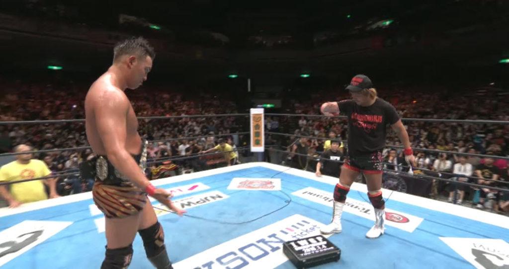 Tetsuya Naito and Kazuchika Okada confront one another before Wrestle Kingdom 12
